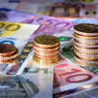 Stock Photo: Coins chart on euro banknotes stock exchange, money in rise