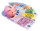 Piggibank on euro banknotes — Stock Photo