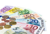 Coins and banknotes euro on white — Stock Photo