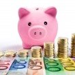 Piggy bank with euro coin stacks and banknotes - increase — Stock Photo