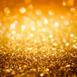 Golden glitter and stars for christmas background — Stock Photo