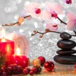 Massage composition christmas spa with candles, orchid, stones — Stock Photo