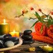 Stock Photo: Preparation for massage in orange lights and black stones