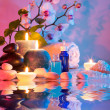 Preparation for bath massage in chromotherapy - cyan red — Stock Photo