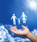 Family dreaming - hand in the sky — Stock Photo