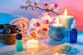Massage and aromatherapy - oil scented, salt, candles, orchid — Stock Photo