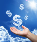 Dollar dreaming - hand in the sky — Stock Photo
