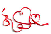Red ribbon that shape a couple of hearts — Stock Photo