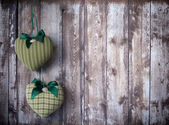 Textile hearts rustics on wood background — Stock Photo