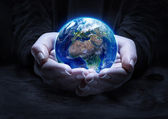 Earth in hands - environment protection concept — Stock Photo