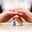 House covered of woman hands - insurance real estate concept — Stock Photo #47384053