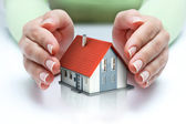 Protect and insurance real estate concept - home covered — Stock Photo