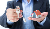 Realtor deliver with house keys — Stock Photo