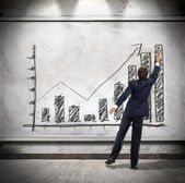 Businessman shows economic growth — Stock Photo