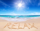 """Word """"relax"""" on the tropical beach — Stock Photo"""