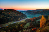 Idyllic Autumn Scenery with Colorful Orange Golden Trees near a lovely Country Road in the rocky Jura Mountains of Bavaria, Germany. Sunset in Fall with a wonderful clear sky in the rural countryside. — Stock Photo