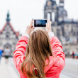Young woman taking a photo — Stock Photo