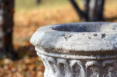 Old urn of stone. — Stock Photo