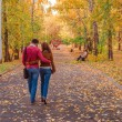 Loving couple in autumn park. — Stock Photo