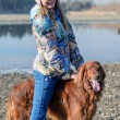 Stock Photo: Girl riding dog.