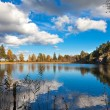 Lake in Sweden reflecting the late summer sky — Stock Photo