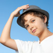 Handsome teenage boy standing outside against a blue sky — Stock Photo