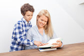 Mother and son are reading — Stock Photo