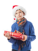 Charming Teenage boy is holding a present — Stockfoto