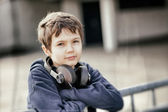 Young boy with headphones in grunge look — Stock Photo