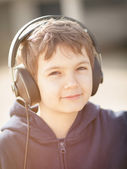 Young boy with headphones in vintage look — Stock Photo