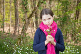 Young girl in a forest — Stock Photo