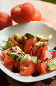 Tomatoes and avocados salad — Stok fotoğraf
