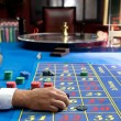 Casino games with gambler hands — Stock Photo #30541983