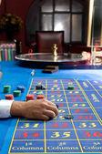 Casino games with gambler hands — Stock Photo