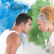 Portrait of couple painting at home — Stock Photo