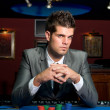 Gambler at casino table — Stock Photo #30683369