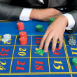 Casino games with gambler hands — Stock Photo #30683391
