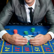 Stock Photo: Casino games with gambler hands