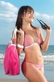 Beautiful girl with bikini at the seaside — Stock Photo