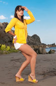 Beautiful woman in yellow looking for somebody — Stock Photo