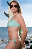 Blonde girl with surfboard — Stockfoto