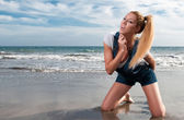 Naughty woman at the seaside laughing — Stock Photo