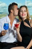 Happy couple with drinks — Stock Photo