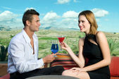 Happy couple drinking — Stock Photo