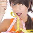 Woman diet eating a tape measures — Stock Photo