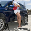 Woman with a broken wheel of her car waiting — Foto Stock
