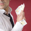Poker player with aces and an ace in his sleeve — Stock Photo
