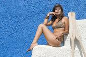 Woman in bikini waiting for her boat with oars — Stock Photo
