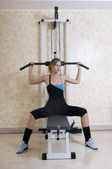 Woman in the gym with weight — Stock Photo