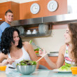 Women enjoying her salad and man — Stock Photo